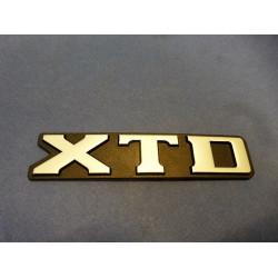 "monogramme ""XTD"""